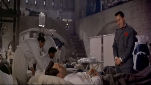 Il cappellano fa visita a Frederic nell'ospedale da campo